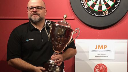 Jason Stalker with Howdens Grand Prix singles trophy at the Sudbury & District Invitational Darts Le