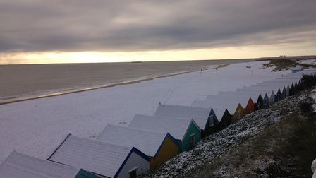 Blanket of snow covers beach huts at Southwold. Picture: JEREMY REEVE