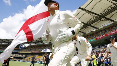 England's Jonny Bairstow runs onto the field at The Gabba, Brisbane. England lost the First Ashes Te