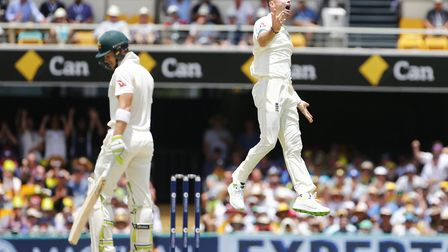 England's James Anderson celebrates the wicket of Tim Paine during day three of the First Test. Engl