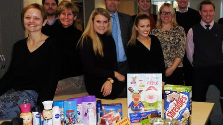 Savills Ipswich staff with their food donations for FIND - Families in Need. Picture: SUE MONKS