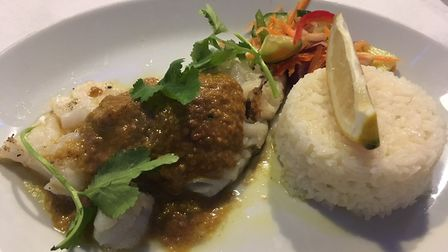 Barbecued cod with Goan red curry sauce and steamed rice at Fish Cafe, Ipswich.