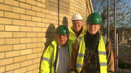 Mills Charity trustees at the new almshouses, l-r Bob Snell,Nick Corke, Persephone Booth, chairman o