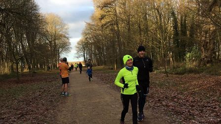 All smiles as well wrapped-up runners near the finish of the Swindon Parkrun last weekend.