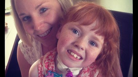 Rebecca Gray with her niece Sophie Harper, who died from a brain tumour aged eight. Picture: REBECCA