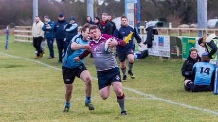 Steve Aspery charges towards the line for West Norfolk in their win at Woodbridge. Picture: SIMON BA