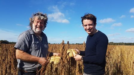 William Hudson of Hodmedod, and Scott Pattison of EDME at a quinoa harvest with bread made from quin