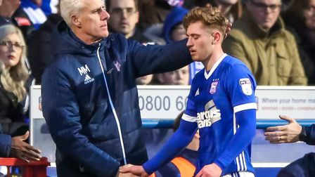 Ipswich Town manager Mick McCarthy consoles Teddy Bishop after his season-ending hamstring injury. P