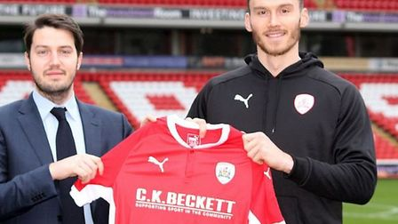 Kieffer Moore (right) has completed a £750k switch from Ipswich Town to Barnsley. Photo: Barnsley FC
