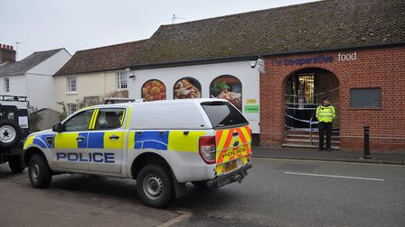 Police investigate the scene of a ram raid on the Co-op in Lavenham. Picture: SARAH LUCY BROWN