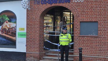 A police officer stands outside the Co-op in Lavenham after it was ram raided overnight. Picture: S