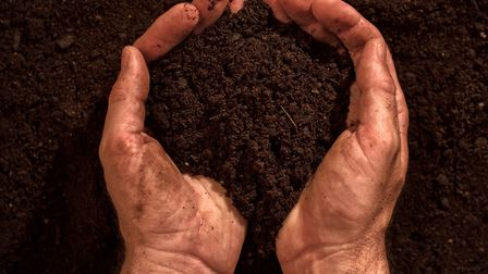 A Generic Photo of a man holding soil. See PA Feature GARDENING Wellbeing. Picture credit should rea