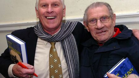 Ray Crawford, left, and Ted Phillips at a book signing in Ipswich in 2007. Picture: ALEX FAIRFULL