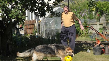 Ted Phillips, pictured in 2013, playing football with his dog Holly.