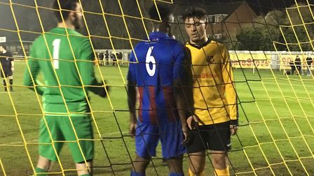 Maldon keeper Tim Brown, who saved a penalty, and defender Grade Milende prepare to deal with anothe