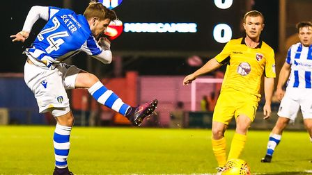 Craig Slater, cracking in a shot against Morecambe this season, has signed on loan for Dundee United