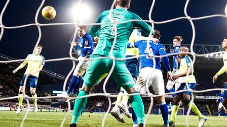 Joe Garner heads a goal back for Town in the 2-1 defeat at the hands of Derby County. Picture: STEVE
