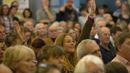 Members of the audience raise their hands to ask a question to Environment Secretary Michael Gove du