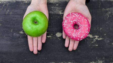 Parents are urged to give children a maximum of two healthy snacks a day. Picture: GETTYIMAGES/ISTOC