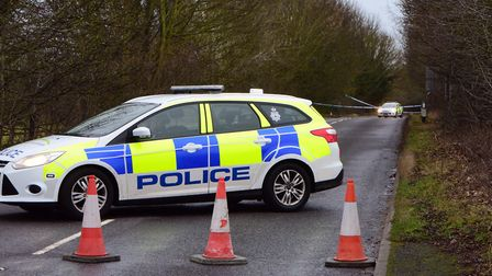 Elmswell Road in Woolpit remains cordoned off as police investigate the scene of an unexplained deat