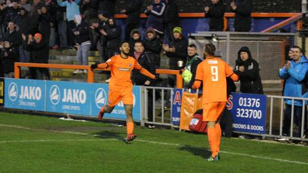 Reece Grant rushes to thank the provider of Iron's fourth goal, Phil Roberts (9). Photos: JON WEAVER