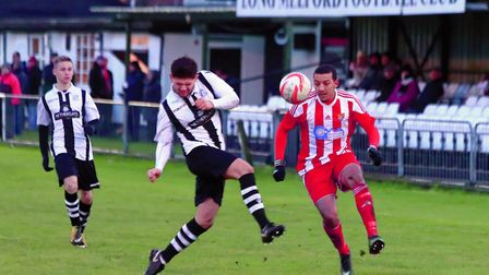 Seasiders' Ethan Clarke in close tussle with Long Melford's Dan Smith at Stoneylands on Saturday. Ph