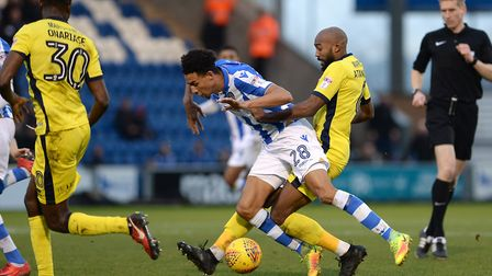 Kurtis Guthrie is brought down by Nigel Atangana during the U's 4-1 home defeat to Cheltenham on Sat