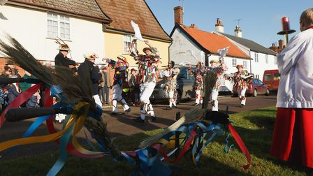 East Suffolk Morris Men carry a plough blessed by The Rt Rev Dr Mike Harrison Bishop of Dunwich from