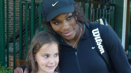 Serena Williams meets a young fan from the Elena Baltacha Foundation. Picture: NINO SEVERINO