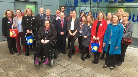 Parents and childcare providers join campaigning Labour councillors before a county council meeting