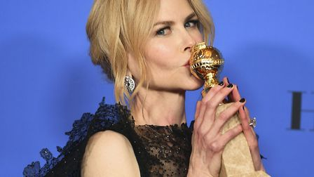 Nicole Kidman poses in the press room with the award for best performance by an actress in a limited