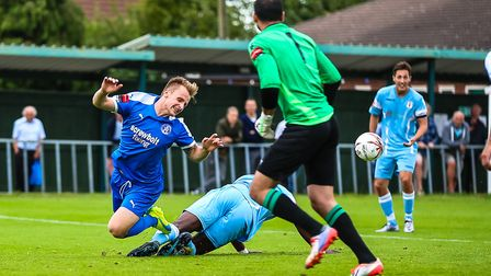 Byron Lawrence of Leiston takes a dramatic fall. He and his team-mates entertain Lowestoft on Boxing