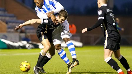 Ryan Jackson wrestling with Danny Pugh during the U's 1-1 home draw against Port Vale. Picture: STE