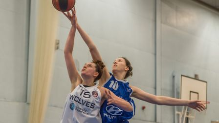 Maya Price makes a block for Ipswich. She added 20 points in the win over Worcester. Picture: PAVEL