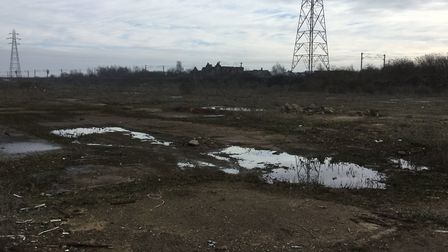 The new depot would be built on this derelict site next to the rail line at Brantham