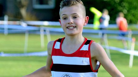 Lewis Sullivan, enjoying his recent victory at the Suffolk Championships, won the junior boys' race
