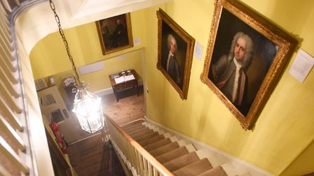 The beautiful staircase covered in Gainsborough's paintings. Picture: GREGG BROWN