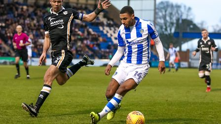 Brandon Comley, on the ball, has signed for Colchester United permanently. Picture: STEVE WALLER