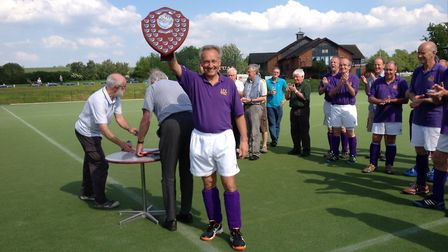 Hockey East won the over 65s trophy for the first time. Roger Girling, from Ipswich, with the troph