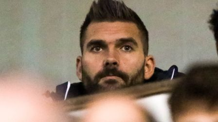 Bartosz Bialkowski, pictured watching the Ipswich Town v Leeds United game, has been linked with Cry