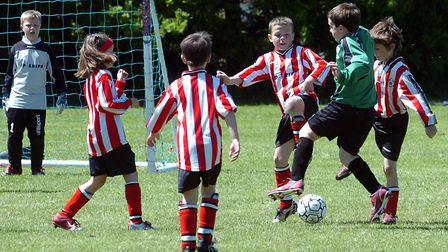 Youngsters enjoying football. Only 0.012% of youth players playing in England today will ever play i
