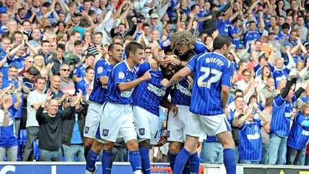 Jason Scotland celebrates with team mates after scoring the equaliser for Ipswich