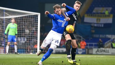 Joe Garner and Liam Cooper battle during the Ipswich Town v Leeds United match. Picture: STEVE WA