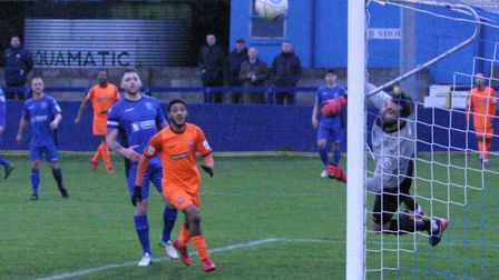 Chippenham keeper Jared Thompson saves a shot from Braintree's Ricky Gabriel. Picture: JON WEAVER