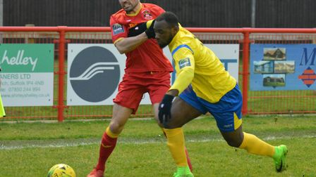 Needham's Luke Ingram battles for the ball in their defeat to Kingstonian. Picture: BEN POOLEY