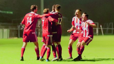 Felixstowe players celebrate their late winner against Thetford Town. Picture: STAN BASTON