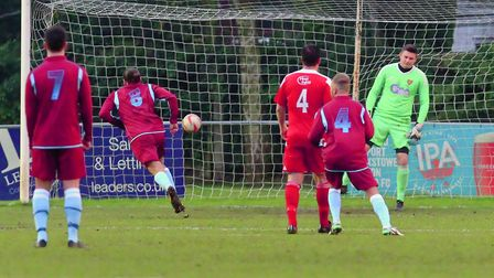 Max Melanson wrong foots Danny Crump from the penalty spot to open the scoring for Thetford against