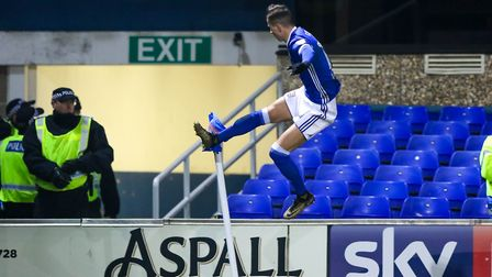 Bersant Celina does a flying kick celebration after his match-winning goal against Leeds. The Man Ci