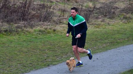 One man his dog at the Great Notley parkrun, held near Braintree on Saturday. Picture: MIKE ELDRED