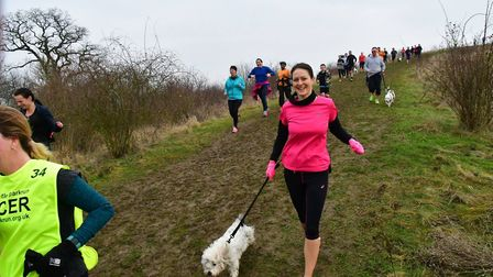 Runners and dogs descend from the 'Bird of Freedom' Hill at Saturday's Great Notley parkrun. Picture